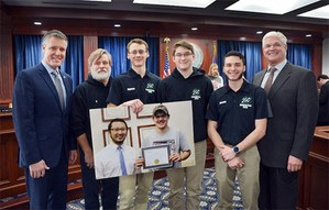 CW Tech students pose with their advisor Dale Quattrin, and Sen. John Proos at the capital in Lansing after testifying before the Senate committee.