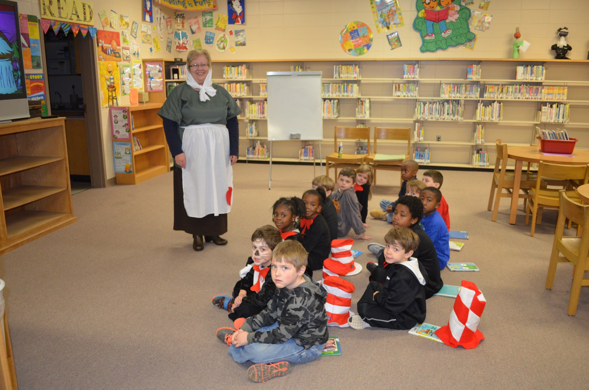 BES Librariand and students celebrate Read Across America Day.  Librarian portrays the character Strega Nona and students are dressed as Cat in the Hat.