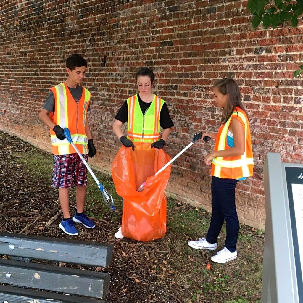 High school students cleaning campus