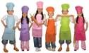 children dressed as chefs