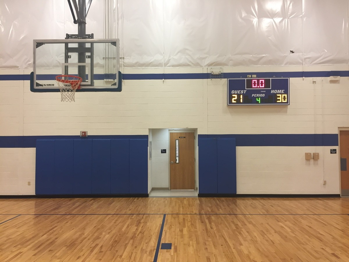 Picture of our Gym and Scoreboard