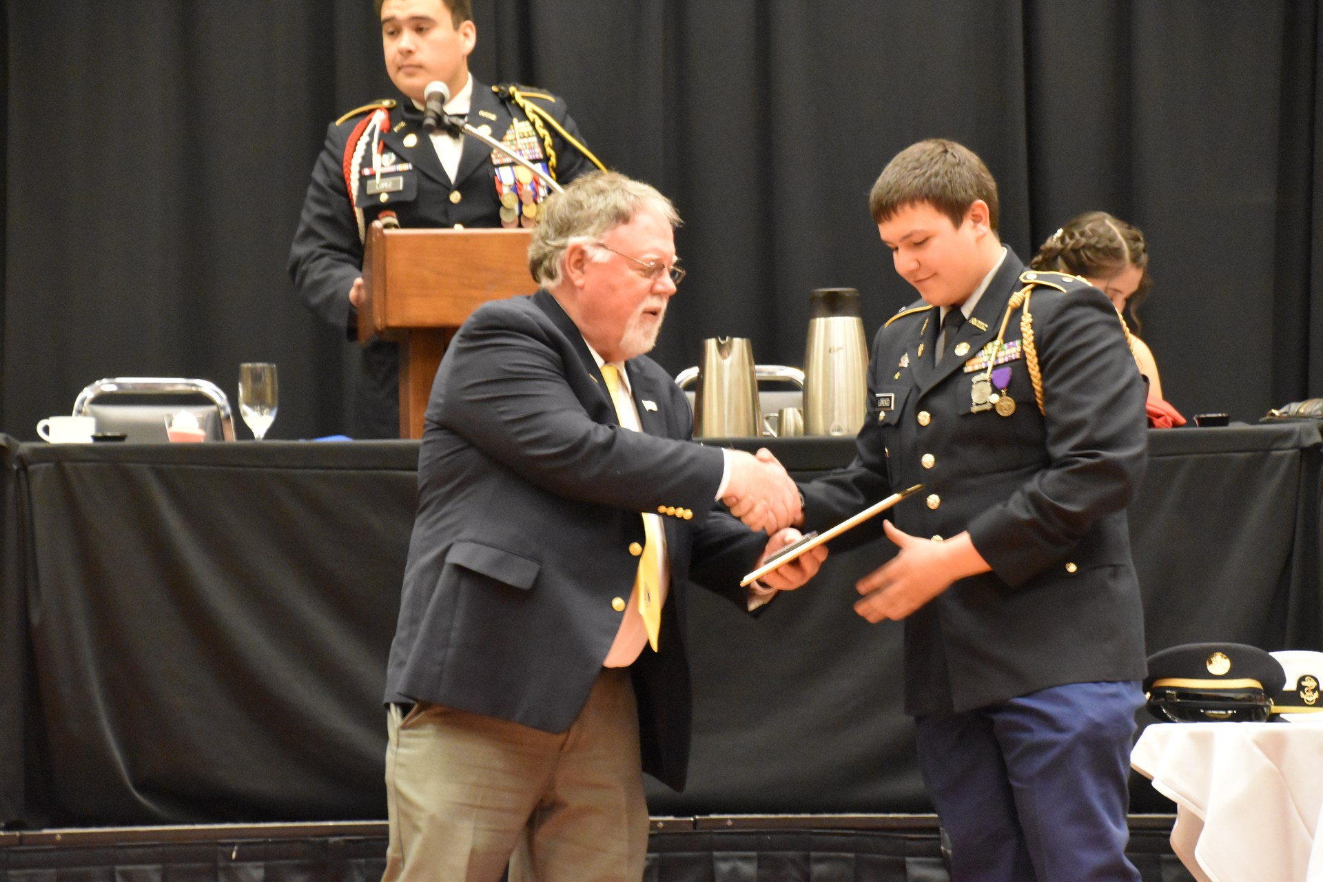 Student receiving award.