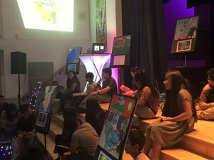 Heath Elementary sixth-grader Damian Alcala recites a poem about a lion while partner Adrian Ortiz provides a beat at an April 12 art gallery celebrating a yearlong effort to integrate arts into core curriculum at two Baldwin Park Unified elementary schools.
