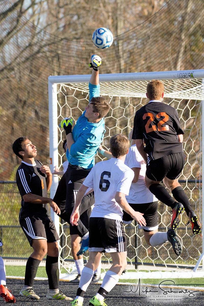 CHS boys soccer goalie blocks a shot