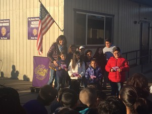 Students receiving the Pawsome Student Yard Duty Award at outside assembly
