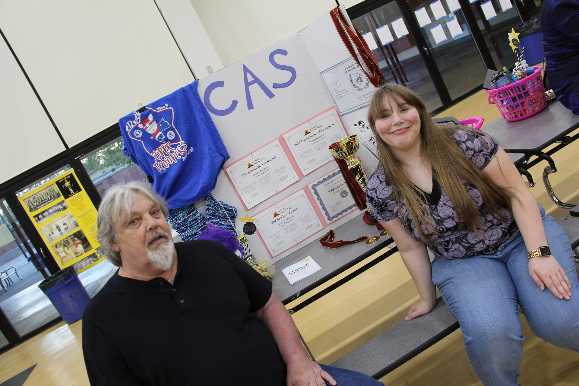 Image of IB Diploma Candidate with her Dad and presentation board at CAS Celebration Event