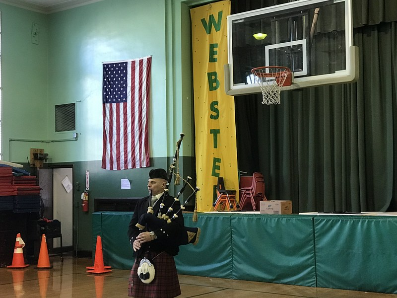 Bagpiper entertains students