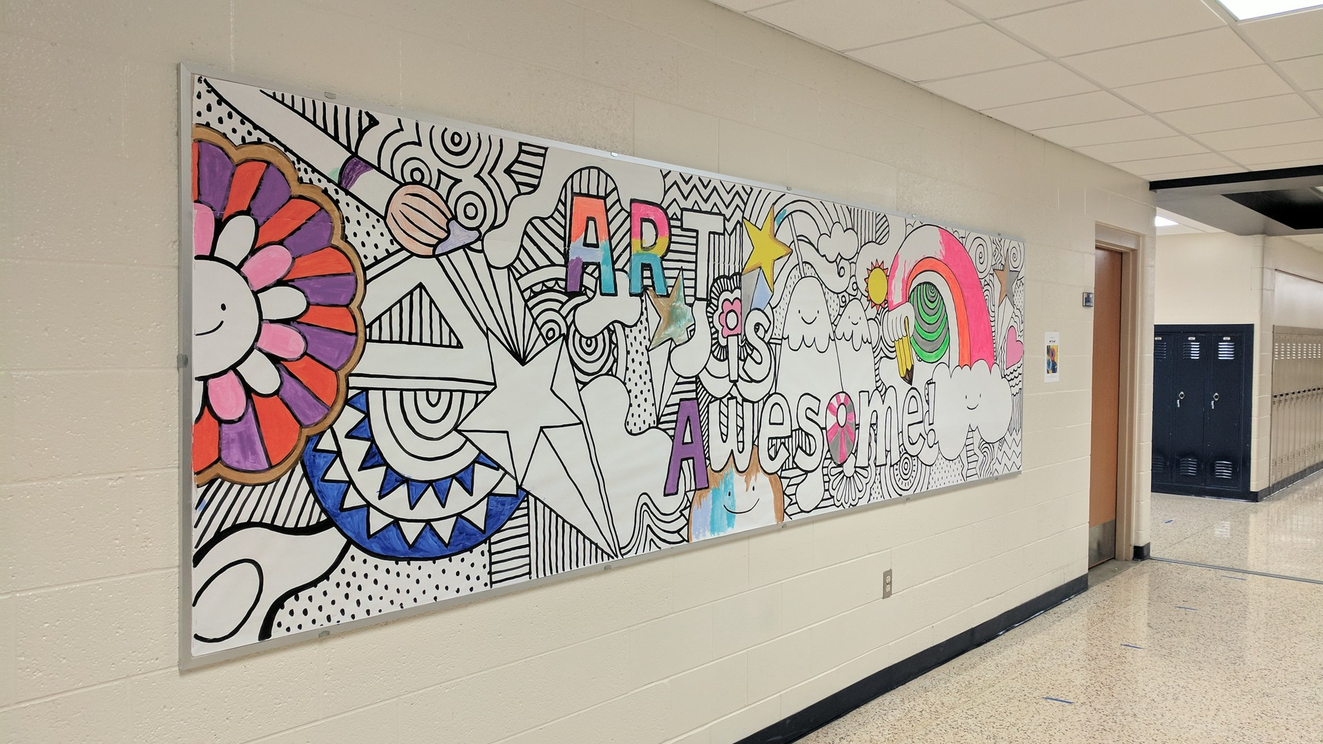 A little more is painted on the 'Art is Awesome' picture outside the art room.