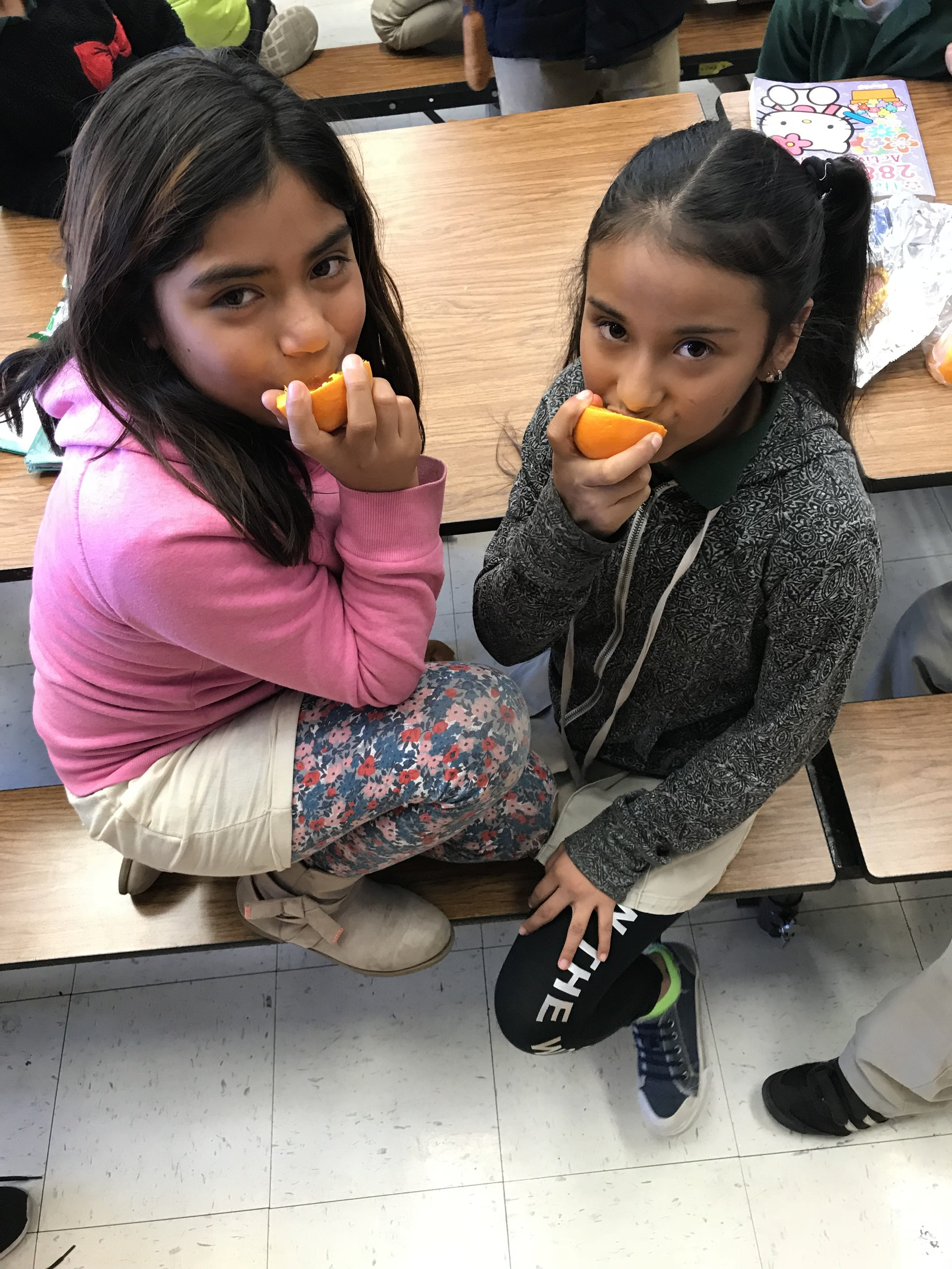 students eating oranges