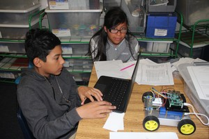 Students with computer and robot