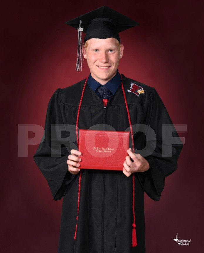 Posed Diploma on a Backdrop