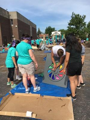 Volunteers help build a playground