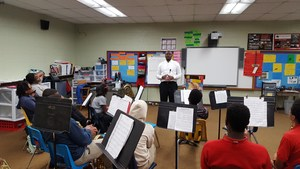 SU Assistant Band Director, Kedric Taylor, coaches the Baker Middle Concert Band