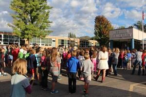 Families in front of Needham School.