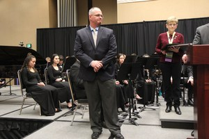 Principal Eric Diener standing on stage while being recognized by the Washington Music Educators Association