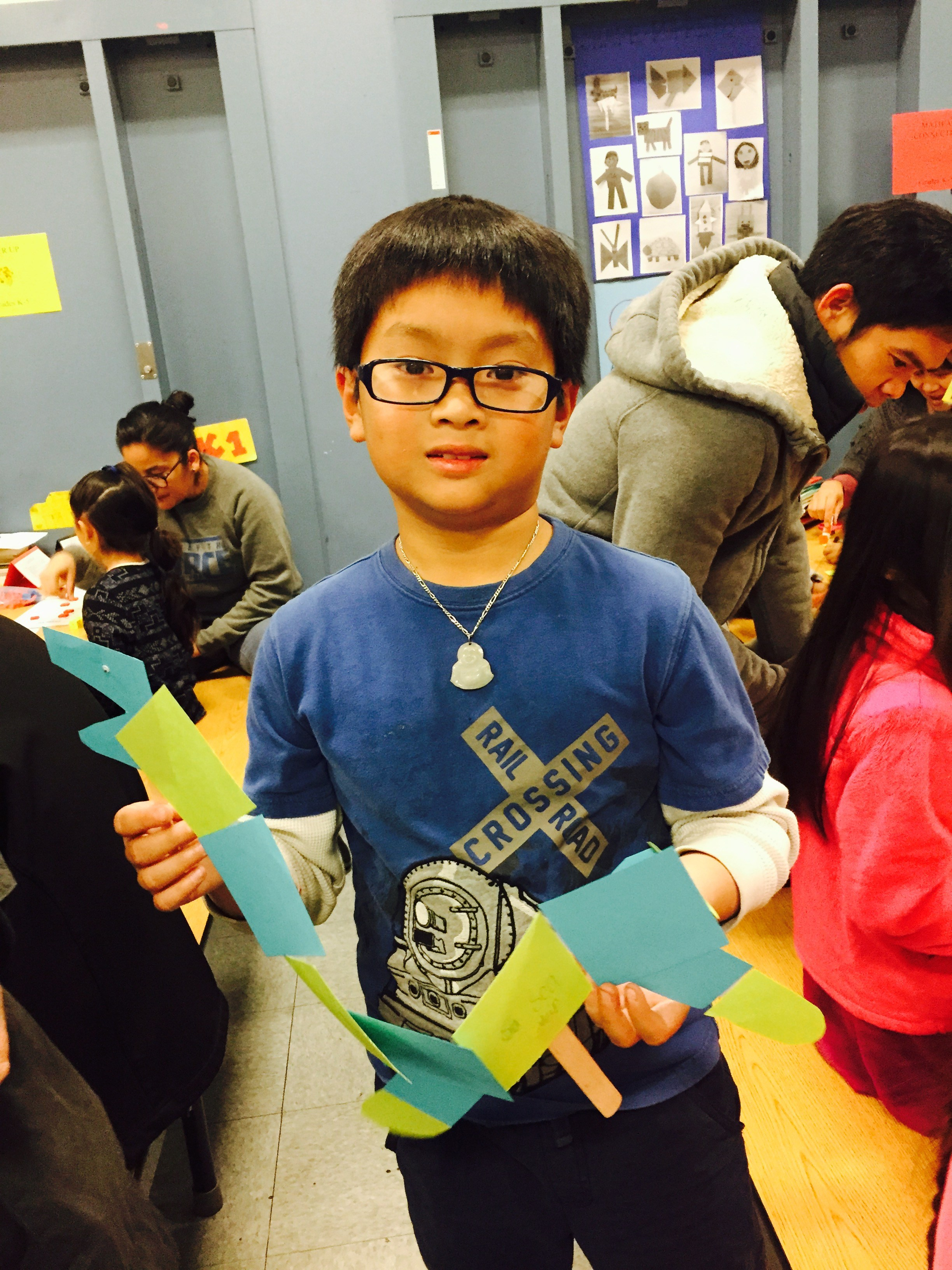 Creating geometric shapes of art during Family math night.