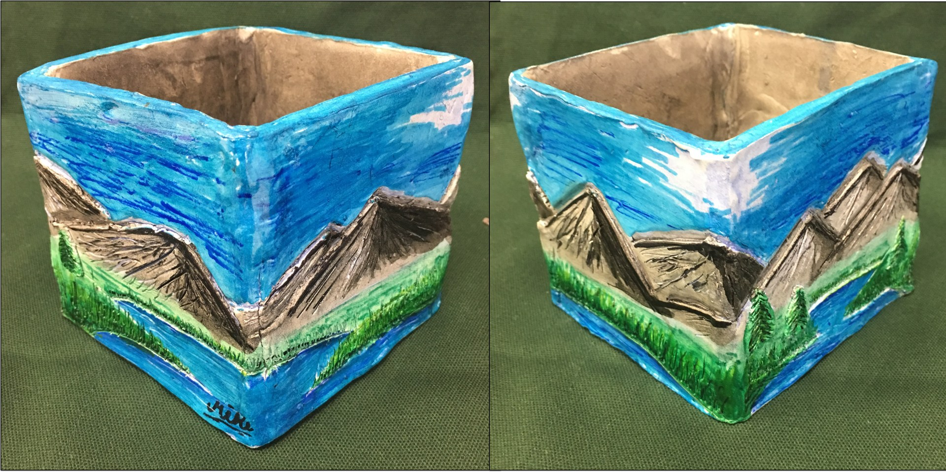 clay box with mountains painted on it