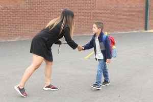 Satus Assistant Principal Relyn Strom greets students on the first day of school