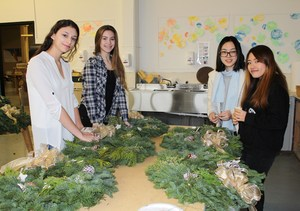 Students decorating the wreaths at the 2016 fundraiser