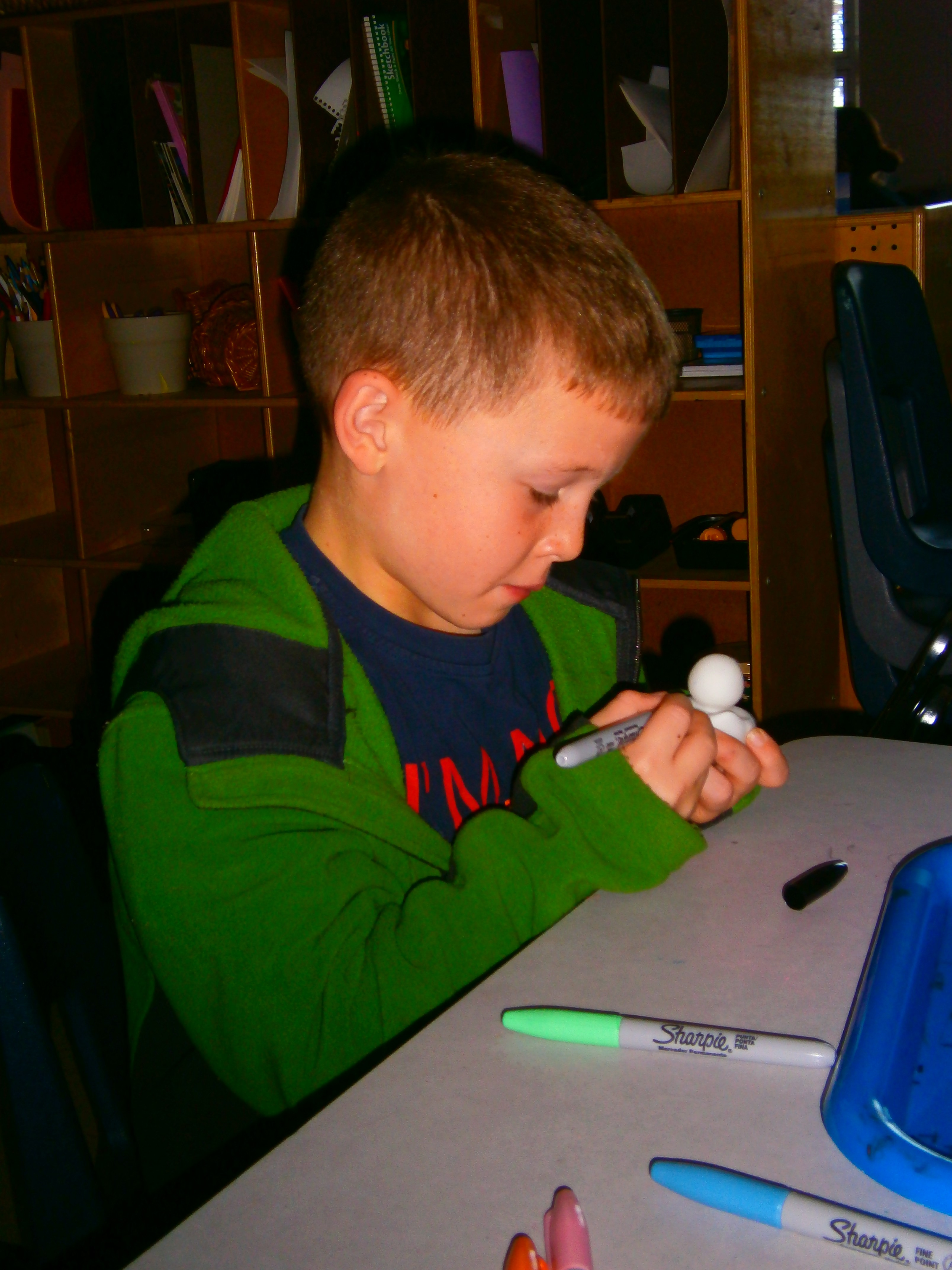 Boy creating a winter craft.