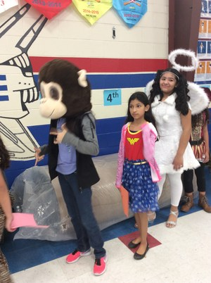Students walking in character parade in gym.