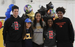 Left to Right seniors Jordan Schakel, Zia Norris, Sydney Hall, Nnena Nadozie, and Ethan Thompson on signing day.