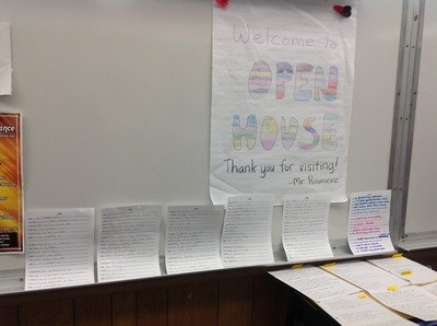 Student papers sitting against a dry erase board.
