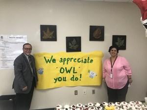 OME Principal Sal Vega and a staff member.