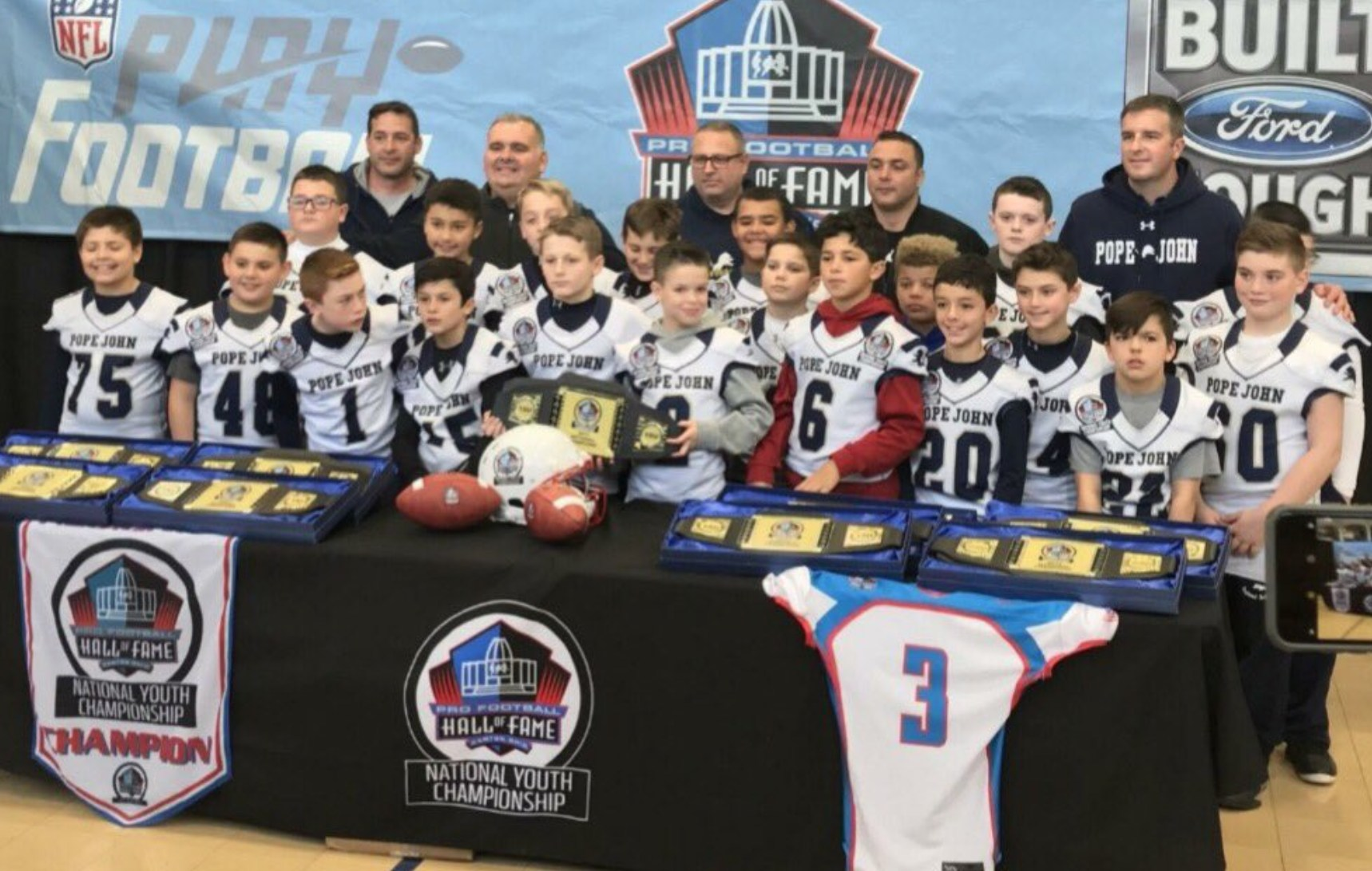 Jr Lions 10U Football team poses for pictures during media day at nationals
