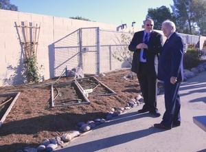 Principal Mark Delano and Under Secretary Kevin Concannon viewing the Winchester garden.