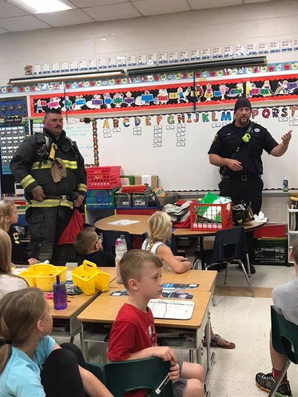 firefighters in an elementary classroom