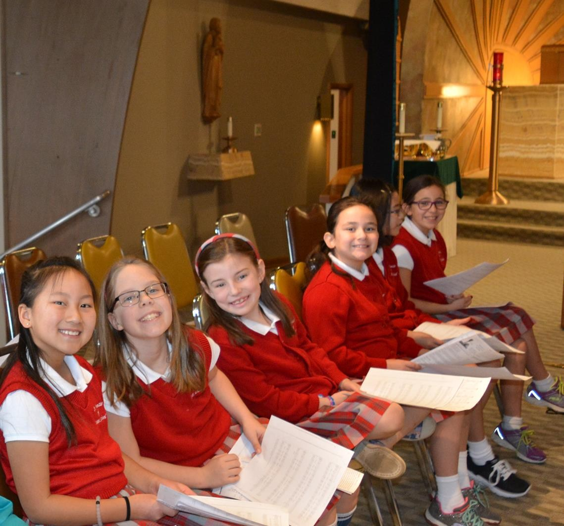 4th grade choir waiting their turn in church