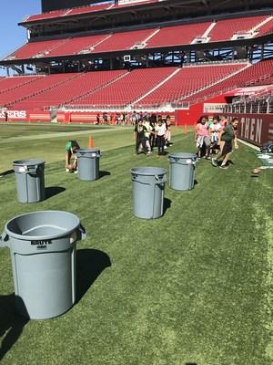 Students run drills on the field at Levi's Stadium