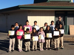 Group of students receiving student of the month awards