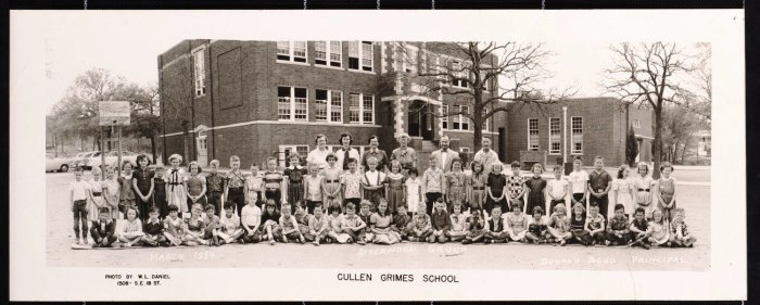 Principal Donald Bond, the teachers and the students of the afternoon group at Cullen Grimes School in Mineral Wells, Texas congregate in front of the building in March of 1954.
