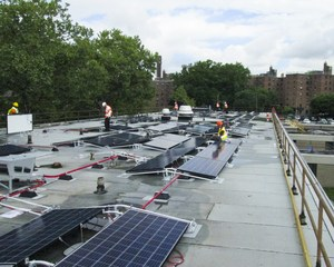 broad view of roof with many solar panels.