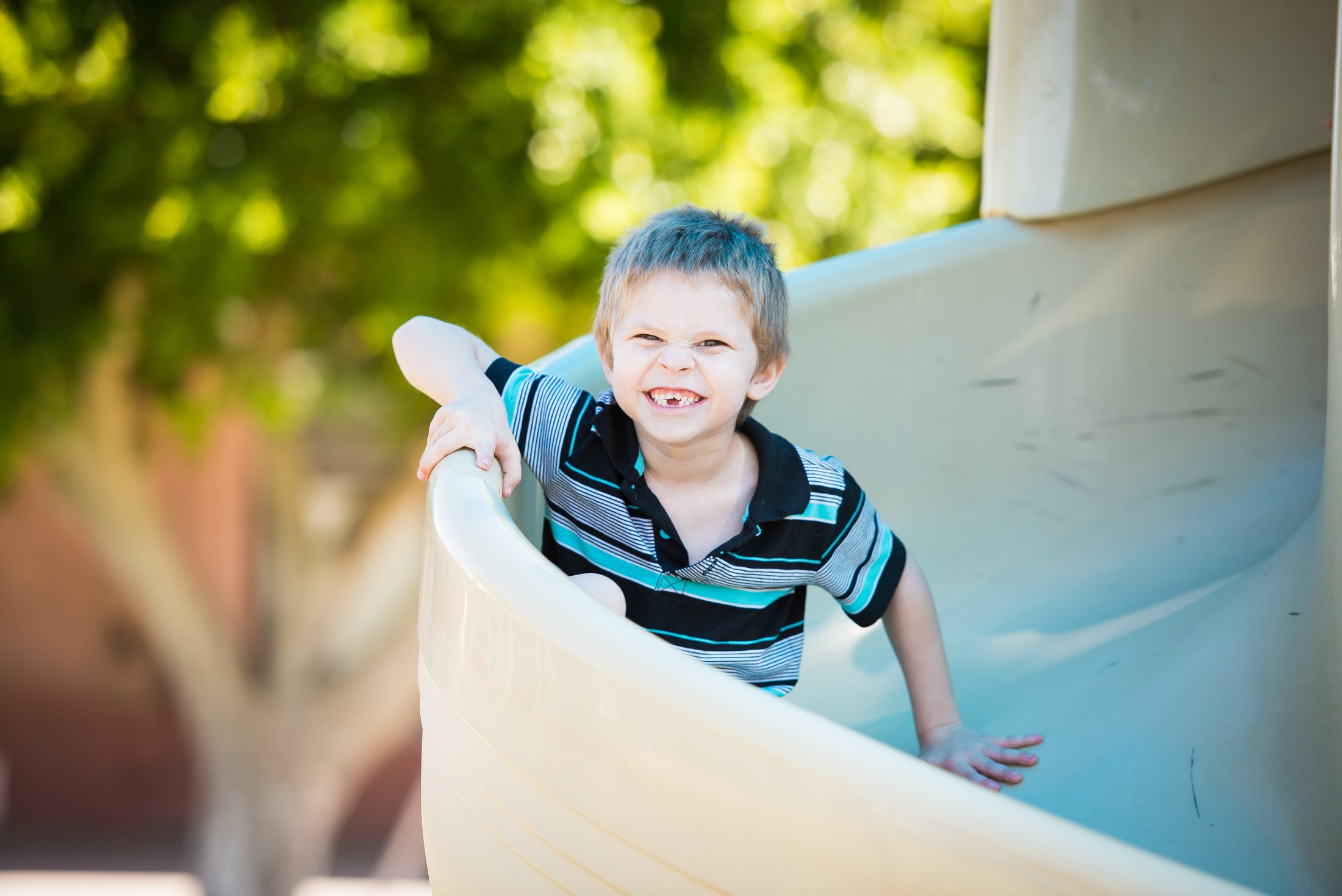 PUSD Kindergarten student on slide