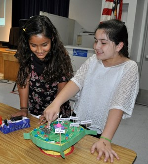 BPUSD_TALK_2: Walnut Elementary fifth-graders Andrea Salazar and Genesis Esparza examine a model of cell after giving KIDS Talks on Oct. 30 on the power of STEAM instruction.