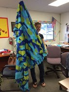 Photo of student holding up a no-sew blanket