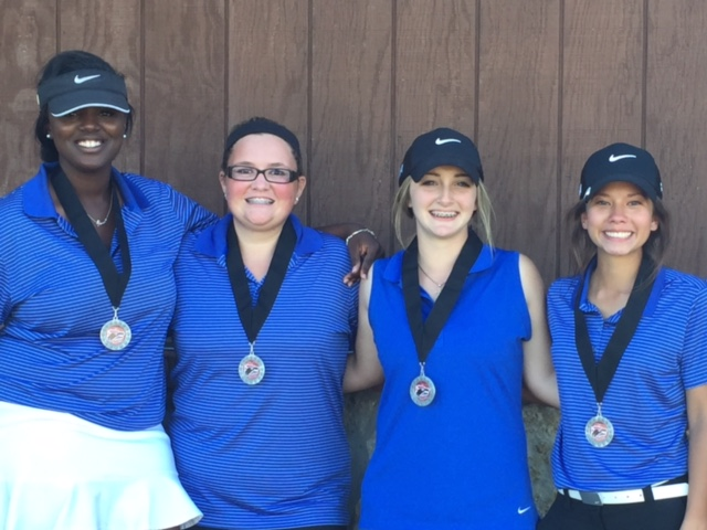 girl golf members with medals