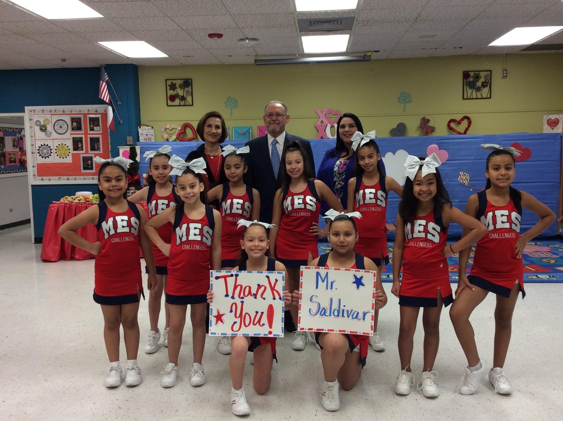cheerleaders performing in the gym.