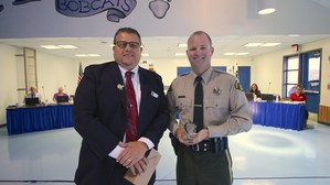 Darel Hansen presenting a Good Apple Award to Deputy Jeremy Parsons