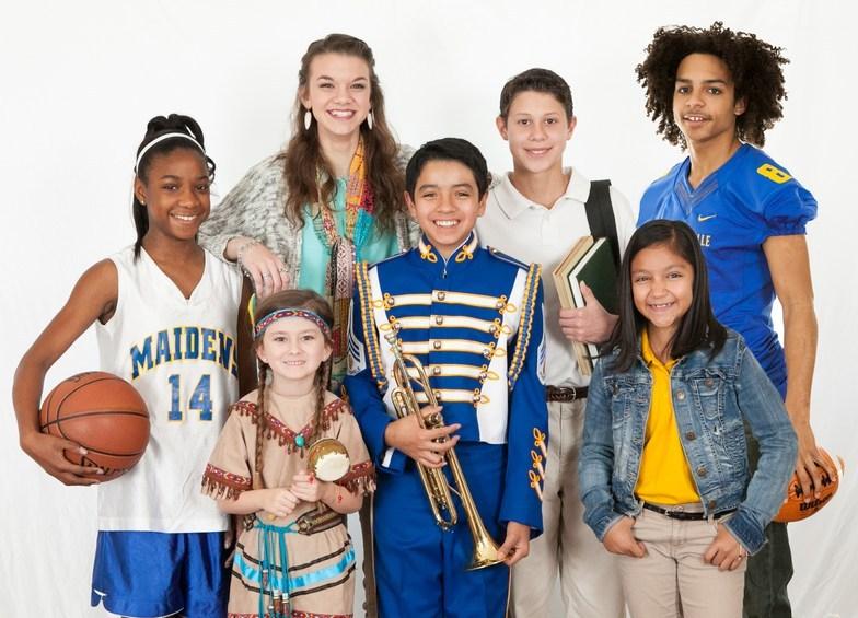 Choir students on a billboard