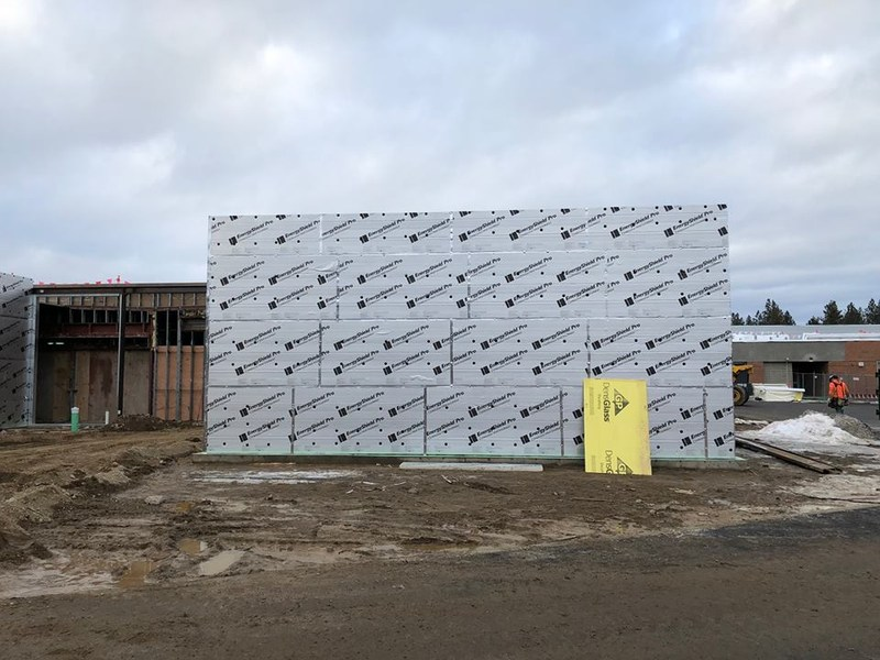 Exterior insulation now on buildings.