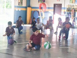 Students practicing ball-handling skills