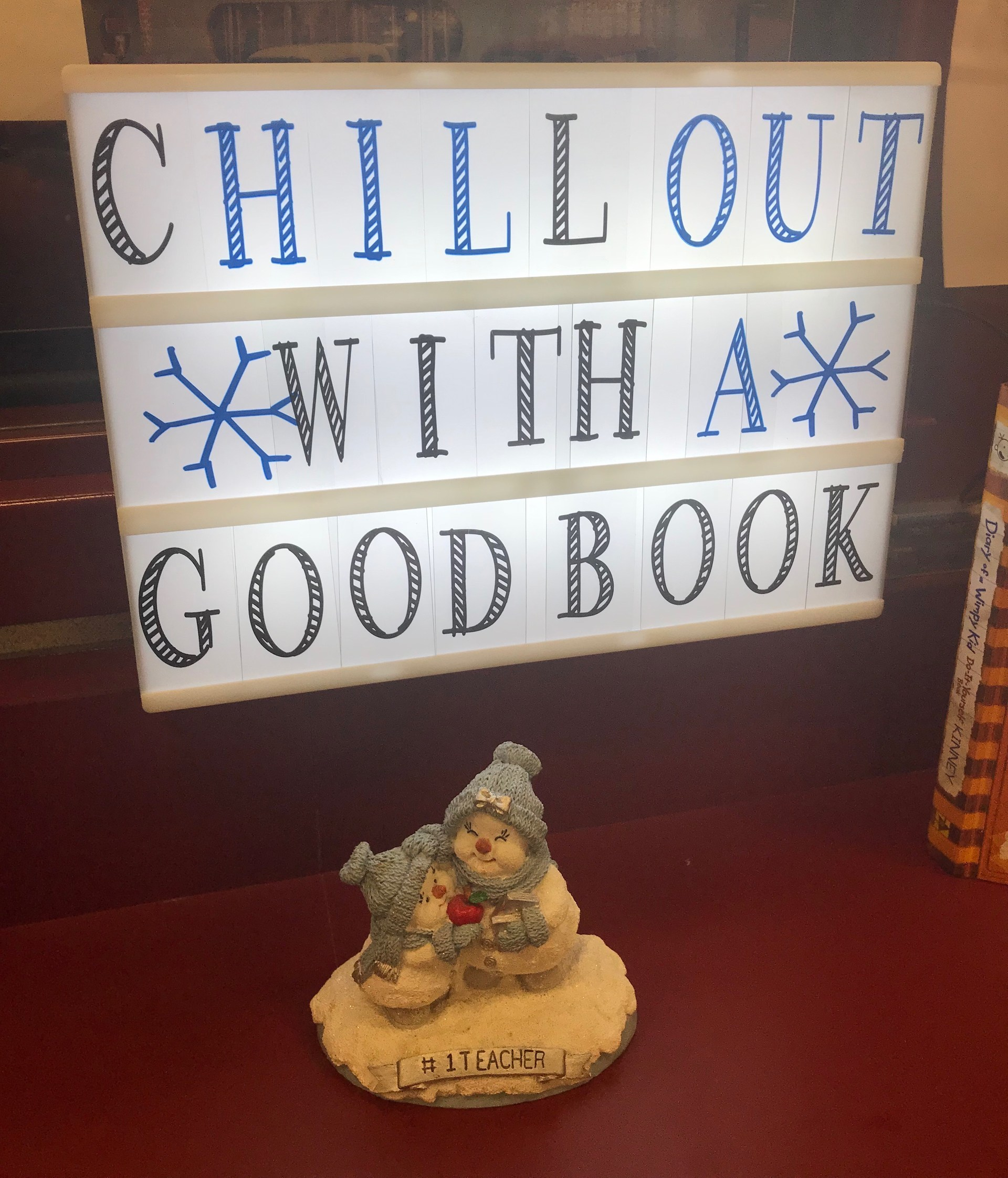 Chill out with a good book sign