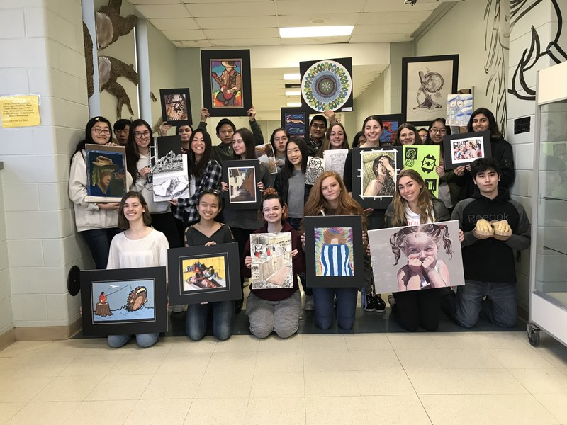 photo of students with artwork