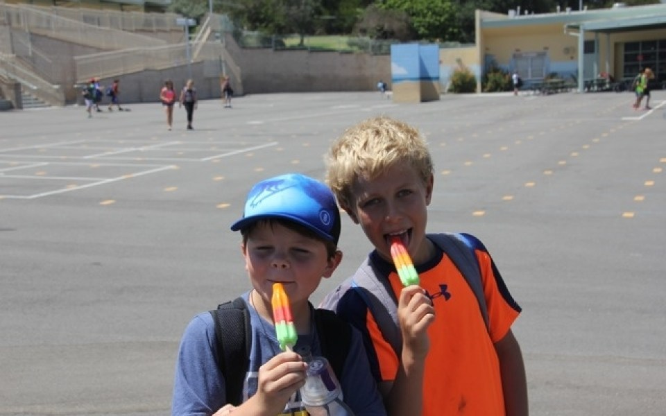 two kids with popsicles