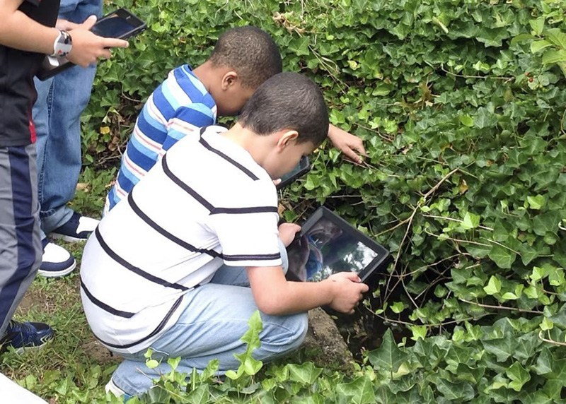 Students Using iPad to collect data at Rose Garden