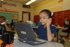 Student at computer, classroom